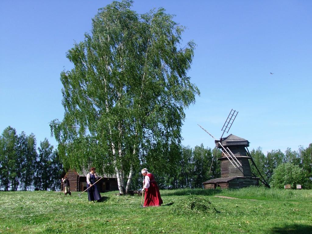 La vie paysanne, au fond deux immenses moulins à vent.